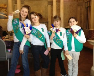 Girl Scouts posing with their embellished fans