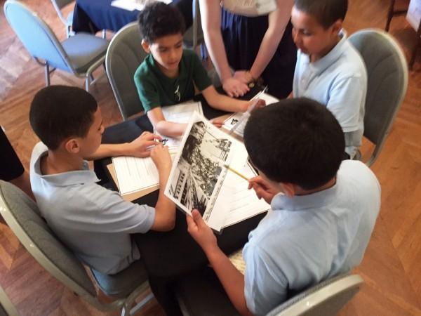 Kids Looking At Historic Photos