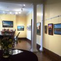 Gallery with landscape art