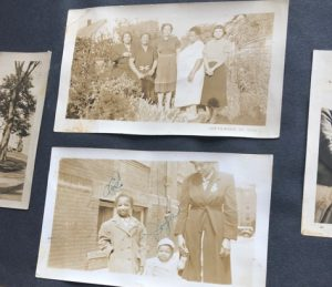 two black and white photos in a scrapbook of black families