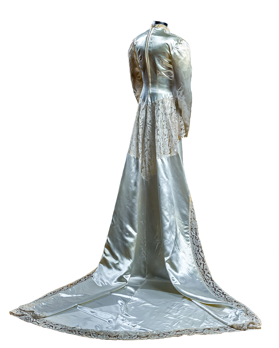 Ivory Skinner satin bridal gown with mandarin collar neckline, fitted bodice, with lace skirting, full skirt and court length (72