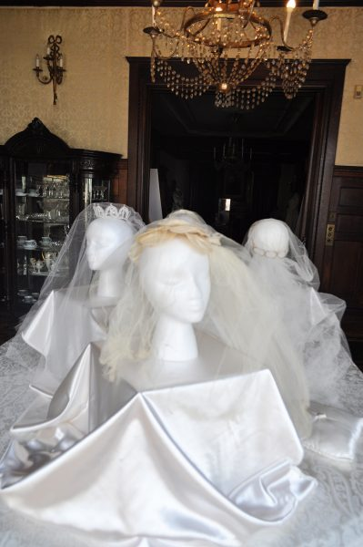 Veils And Tiaras Are On Displau Heads And A Silk Covered Table In The Dining Room